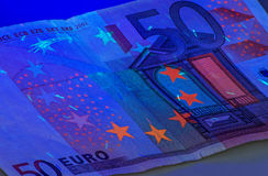 Euro sob a luz ultravioleta Foto de Stock Royalty Free
