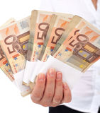 Euro stacks in woman hand Royalty Free Stock Photography