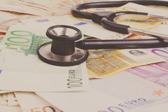 Euro and Stethoscope Stock Images