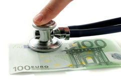 Euro with stethoscope and finger. One hundred euro with stethoscope and finger royalty free stock images