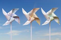 Euro stuk speelgoed windmolens Royalty-vrije Stock Foto's