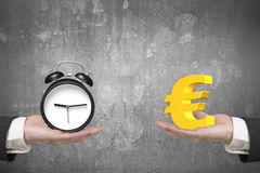 Euro symbol and alarm clock with two hands Stock Images