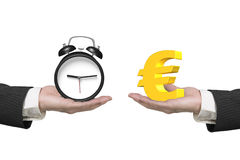 Euro symbol and alarm clock with two hands Stock Photography