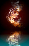 Euro symbol burning, fire with reflection. In water Royalty Free Stock Image