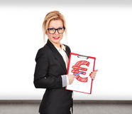 Euro symbol. Businesswoman holding clipboard with drawing euro symbol Stock Photo