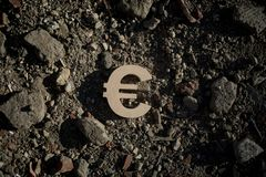 Euro Symbol on Dirt or Debris royalty free stock images