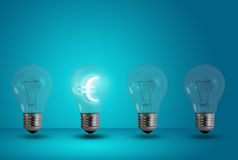 Euro symbol glow among other light bulb Royalty Free Stock Image