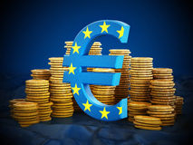 Euro symbol and gold coins stack. On blue background Royalty Free Stock Image