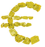 Euro symbol from gold nugget Stock Photos