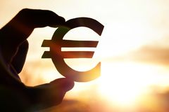 Euro symbol in hand Royalty Free Stock Image