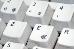 Euro symbol on keyboard. Macro view of dirty or used computer keyboard with Euro key Royalty Free Stock Photo
