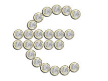 Euro symbol made of coins Stock Photos