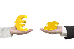 Euro symbol and puzzle piece with two hands Royalty Free Stock Image