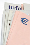 Euro symbol on Stacked newspapers Stock Photo