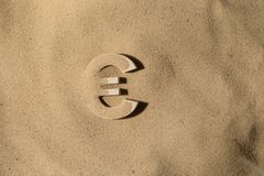 Euro Symbol Under the Sand royalty free stock photos