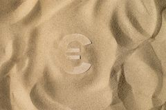Euro Symbol Under the Sand stock photos