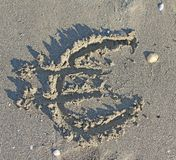 EURO symbol written large on the sand of the Beach Stock Image