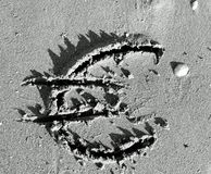 EURO symbol written large on the sand of the Beach Royalty Free Stock Photo