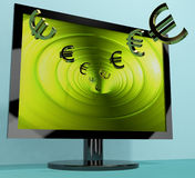 Euro Symbols From Computer Screen Showing Money Stock Photo