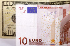 10 euro on $ 10. Ten euro against ten dollars stock photography