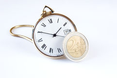 Euro Time. Concept image. Old fashioned pocket watch and new Euro coin. Is time running out for the Euro-zone countries? Copy space royalty free stock photography