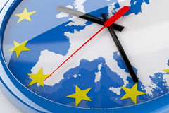 Euro Time. Euro crisis concept created in 3D. A clock with the center of the hands in Germany and the hands pointing to countries with problems:  Ireland, Spain Royalty Free Stock Images