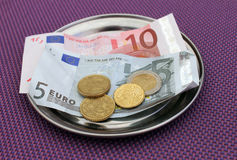 Euro tips on restaurant table Royalty Free Stock Images