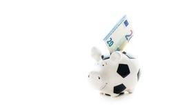 Euro tjugo i Piggybank isolerade på vit bakgrund besparingar Arkivfoto