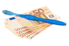 Euro and tooth brush Royalty Free Stock Images