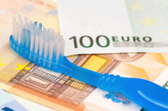 Euro and tooth brush Royalty Free Stock Photo