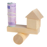 Euro and toy house. Estimation of expediency of purchase of the real estate Stock Image