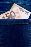 Euro in trouser pocket Stock Photos