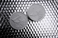 Euro two silver coins over bright steel Stock Photos