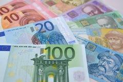 Euro and Ukrainian paper money, background Stock Image