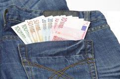 Euro in una casella dei jeans Immagine Stock