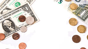 Euro und Dollar legen das Entgegensetzen über Weiß und die Schattenbilder von Stockfotos