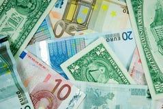Euro- und Dollarhintergrund. Stockfotografie