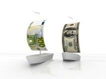 Euro- und Dollarsegelnboote Stockfotos