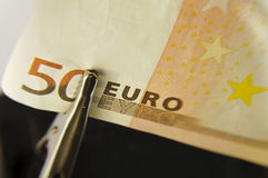 Euro under magnifying glass Royalty Free Stock Image