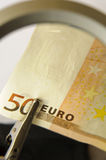 Euro under magnifying glass Stock Photo