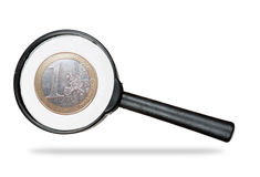 Euro under real magnifying glass over white Royalty Free Stock Photography