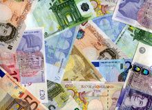 Euro and United Kingdom banknotes background Stock Photo