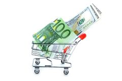 Euro and US dollar banknotes in shopping cart Royalty Free Stock Images