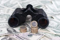 Euro and US Dollar with binoculars Stock Images
