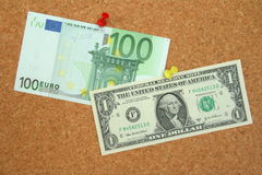 Euro versus dollar. On the pinboard stock photography