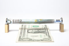 Euro vs Dollar. Secured Euro bill against the dollar bill concept on white background stock images