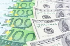 Euro vs dollar. Stack of euro and dollar banknotes stock photos