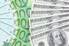 Euro vs dollar. Stack of euro and dollar banknotes stock images