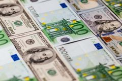 Euro banknotes close up. Several hundred euro banknotes. Euro vs dollar as background royalty free stock photography