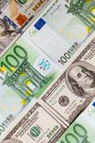 Euro banknotes close up. Several hundred euro banknotes. Euro vs dollar as background stock image